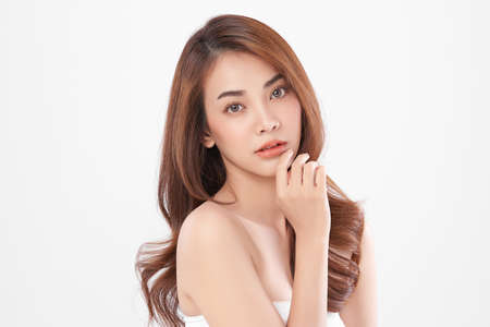 Beautiful young asian woman with clean fresh skin on white background, Face care, Facial treatment, Cosmetology, beauty and spa, Asian women portrait. Standard-Bild