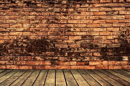 Brick wall with wooden walk way photo