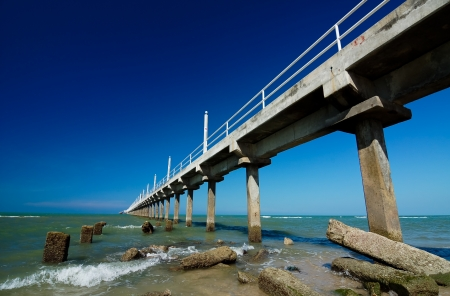 Extend: Beautiful blue sky with concrete jetty