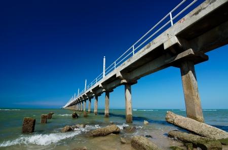 sameness: Beautiful blue sky with concrete jetty