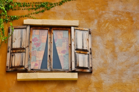 Vintage wooden windows on yellow wall texure