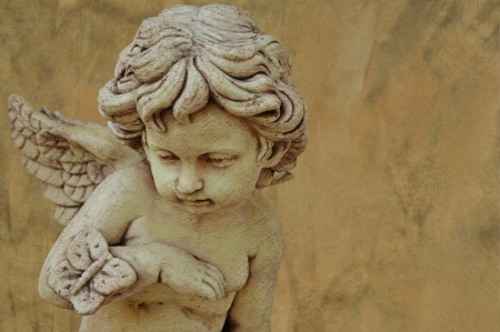 cupid sculpture with grunge background photo