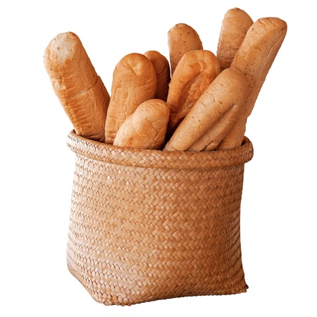 French Bread  Baguette  - in basket over white background  Stock Photo