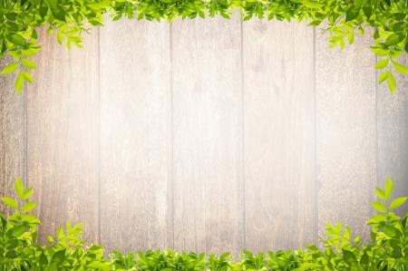 leaves frame on wooden background