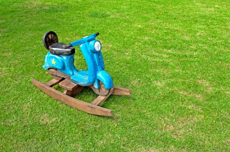 Toy Rocking Scooter on green grass photo