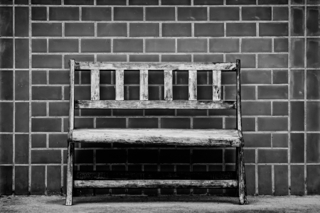 bench against a brick wall photo