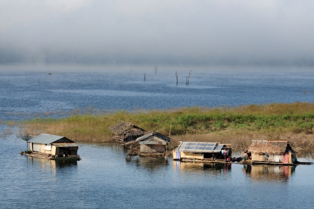 Houses on raft in the lake,Sangklaburi in Thailand photo