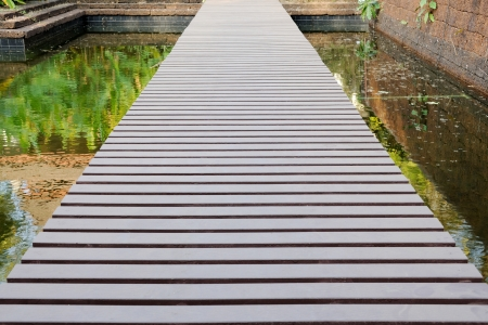 plateful: wooden path in garden Stock Photo