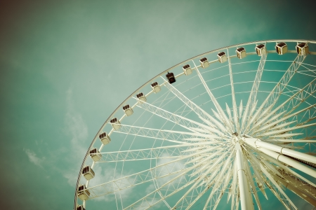 Vintage Ferris Wheel Over Turquoise Sky photo