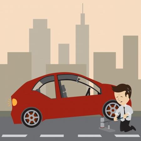 ビジネスマンは、タイヤを変えるジャックを使用します。