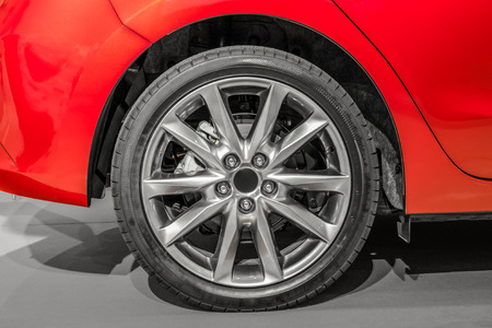 air pressure: Close up rear right of a red sports car