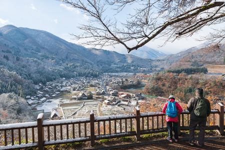 ogimachi: SHIRAKAWA-GO, GOKAYAMA, JAPAN - NOVEMBER 29, 2013 : Tourist looking Japanese village from Shirakawago Shiroyama Observatory Deck. Editorial