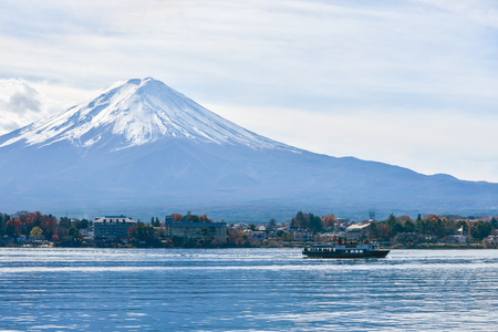 freely: Tourists enjoy freely view Mt.Fuji from the pleasure boat at the Lake Kawaguchiko in winter , Japan