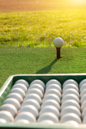 Golf balls on green grass background Stock Photo