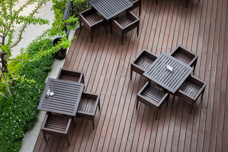 top seven: Top view of table and four chairs on living terrace at cafe.