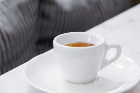 coffee cup on white marble table