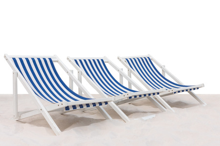 Three blue and white striped beach chair on the sand beach isolated on white background Stock Photo