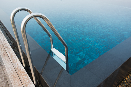 swimming pool with sunny reflections Фото со стока