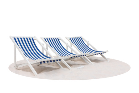 Three blue and white striped beach chair on the sand beach isolated on white background Фото со стока