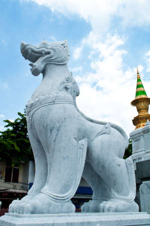 buddhist temple roof: Statue Wat Traimit buddhist temple roof, Bangkok, Thailand Stock Photo