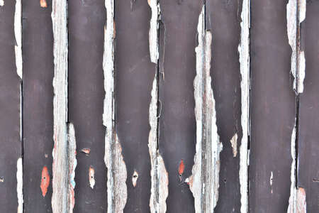 Old wood panels of a boat dock with an extinguished smoking match photo
