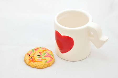 Cup of love and colorful cookie photo