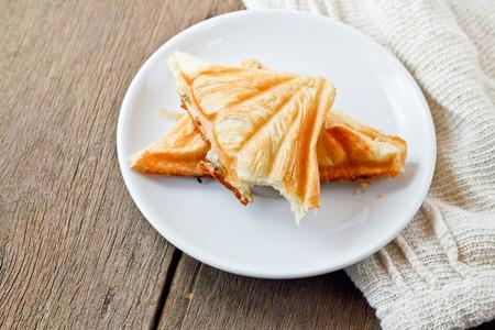 Tuna puff. Tuna sandwich on wood table. photo