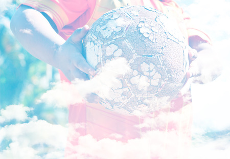 let go: Creative double exposure portrait of young Asian boy combined with sky. (Let go to play soccer.)