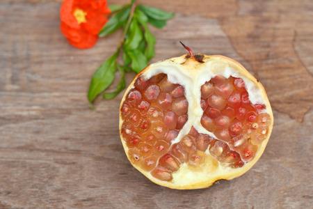 medium group of object: Juicy pomegranates on wood table.
