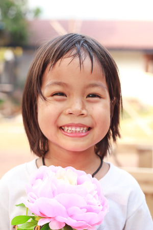 phon: Nongkhai, Thailand - March 16: Unidentified gilr was show her strawberry at Phon Phisai Strawberry farm on Phonphisia in Nongkhai, Thailand on March 16, 2015.