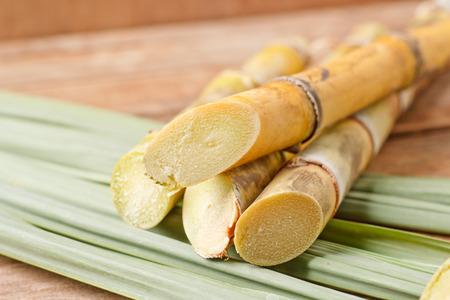 Sugar cane on wood background.