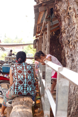 sidewalk talk: Nongkhai, Thailand - Apirl 12: Unidentified old woman talk to her child during wait the ferryboat  at   pier of Nong Kung - Pak Ngum Laosin SongKran day on Ampher Phon Phi Sai in Nongkhai , Thailand on April 12, 2015.