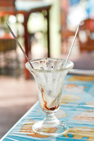 eis: Empty cup of ice cream in restaurant after ate lunch.