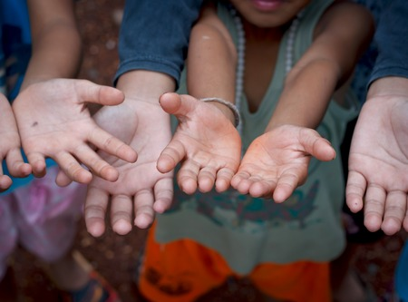 implore: Children Raising hands beg for some food. Stock Photo