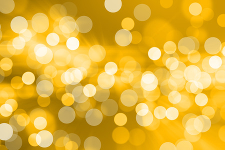 yellow shine: Blurred Lights on yellow background or Lights on yellow background. Stock Photo