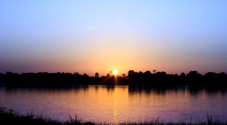 sun set: Gold light on sun set with light on the river.