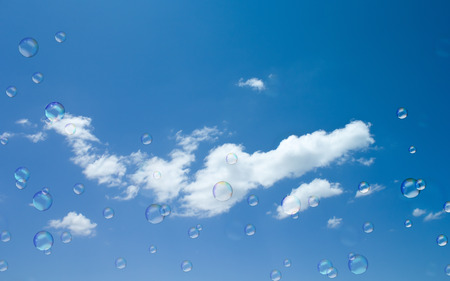 soap suds: Soap suds fly on blue sky background. Stock Photo