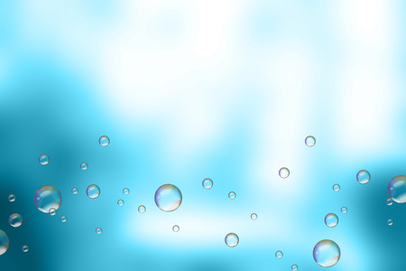 suds: Soap bubbles on blue blurred background.