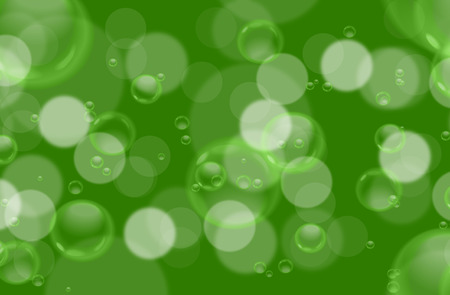 spume: Soap bubbles on green blurred background.