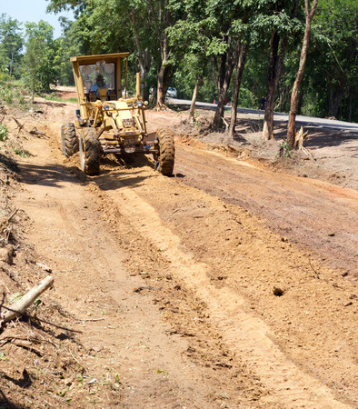 grading: Nongkhai, Thailand - June 30: The Motorgrader  is grading of rural road construction between Ampher Phonphisia to Ampher Pak Kad in Nongkhai, Thailand on June 30, 2015.