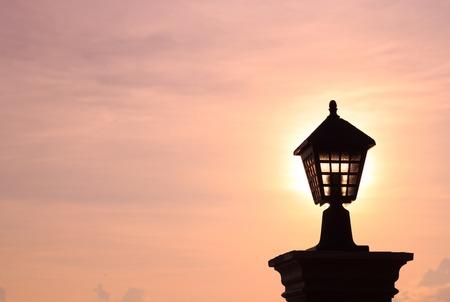 garden lamp: Silhouette of garden lamp on sunset background.