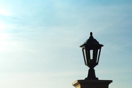garden lamp: Silhouette of garden lamp on blur sky background.