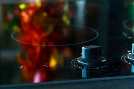 electric stove: Close up of electric stove knobs. Stock Photo