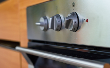 knobs: Close up of electric oven knobs. Stock Photo