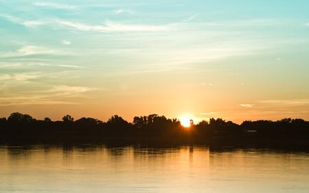 the sun: Gold light on sun set with light on the river.Idyllic Wallpaper Setting Sun.