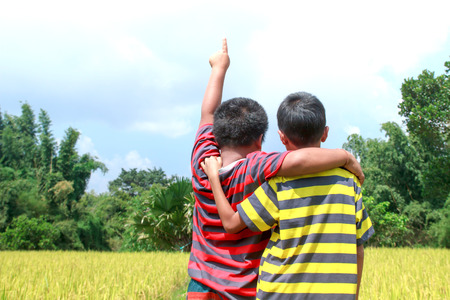 two boys: Two boys playing in rice farm.