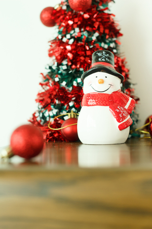 turns of the year: Merry Christmas and happy new year  decoration with snow doll on wood floor.