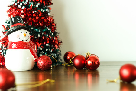 turns of the year: Merry christmas and happy new year  decoration with snow doll on wood floor. Stock Photo