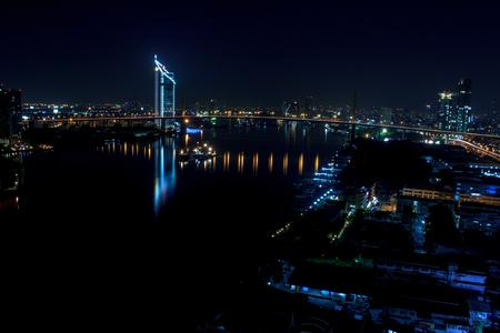 riverfront: Bangkok, Thailand - November 18, 2015 :Perspective of Jaopraya riverfront night  time in Bangkok, Thailand.
