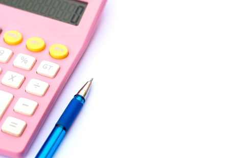action fund: Calculator and pen on white paper.